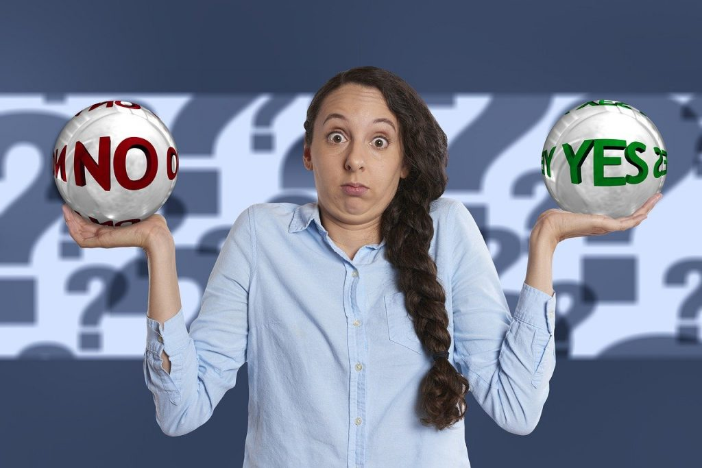 Woman holding Yes/No sign, testing