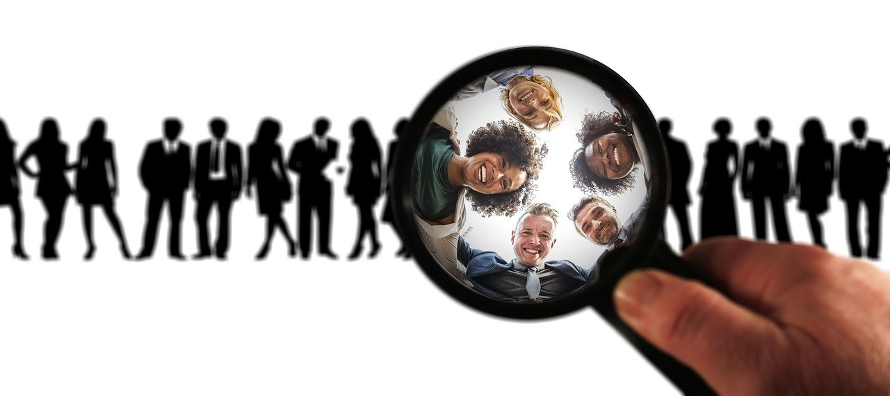 Finding the right people - magnifying glass