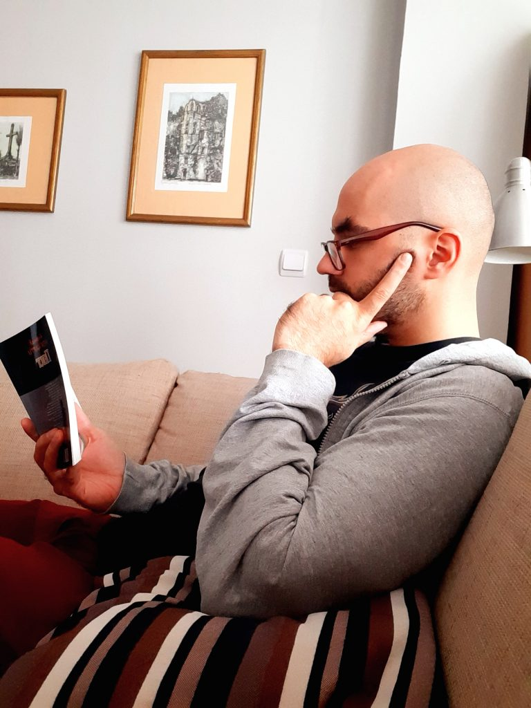 Ideal client profile researcher - Gorazd sitting while reading a book.