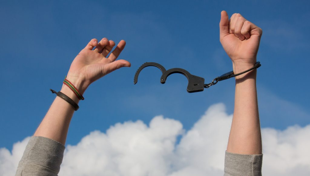 A person freeing out of handcuffs.